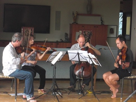 Ebb and Flow musicians rehearse before a performance