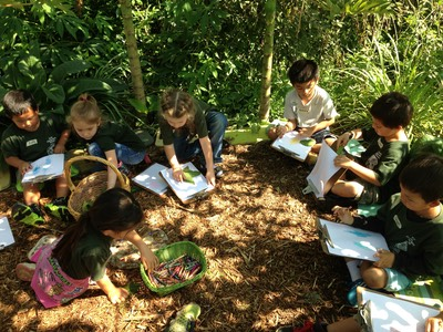 Keiki learning in the garden.