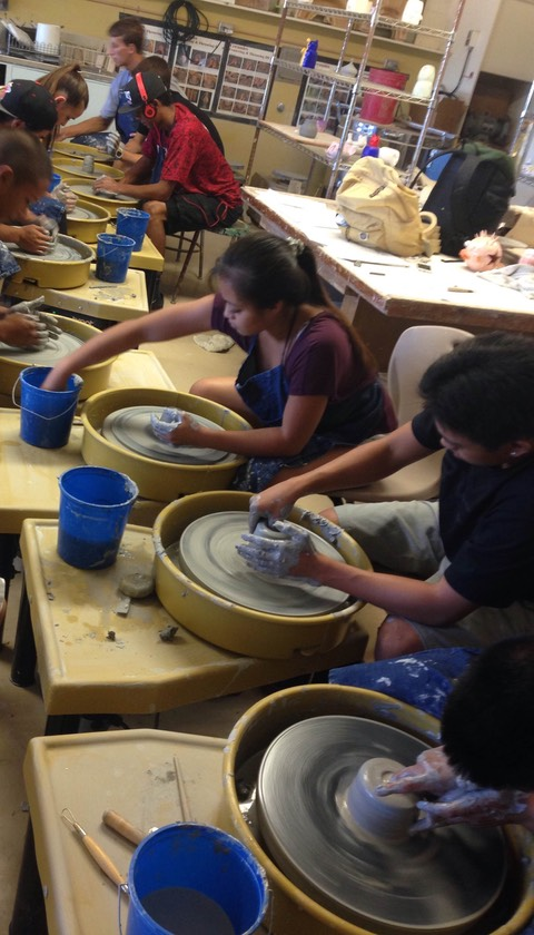 Students working with the new pottery wheels at Lahainaluna High School