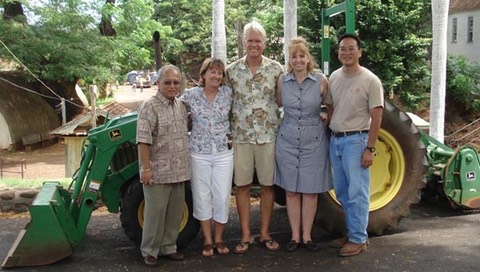 The Makana Aloha board and Principal Nakano and Mr. Ideoka with the newly repaired Tractor at Lahainaluna High School (Oct 2010)